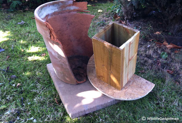Broken planter and wooden tunnel